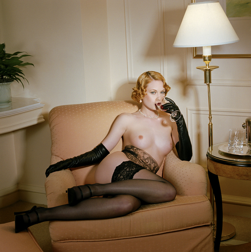 Seana sitting on a golden chair, 2001